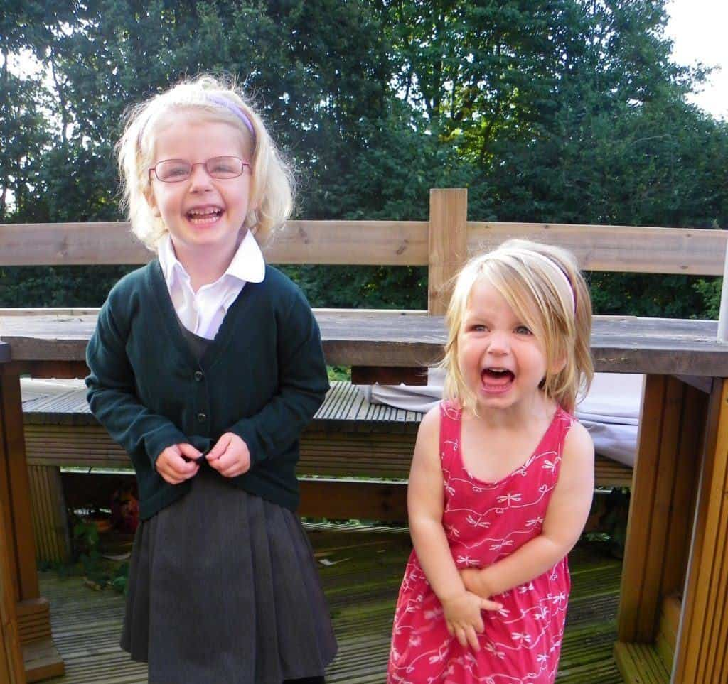 Thursday photo #122 - a weekly photo of two sisters - the one where the eldest started school