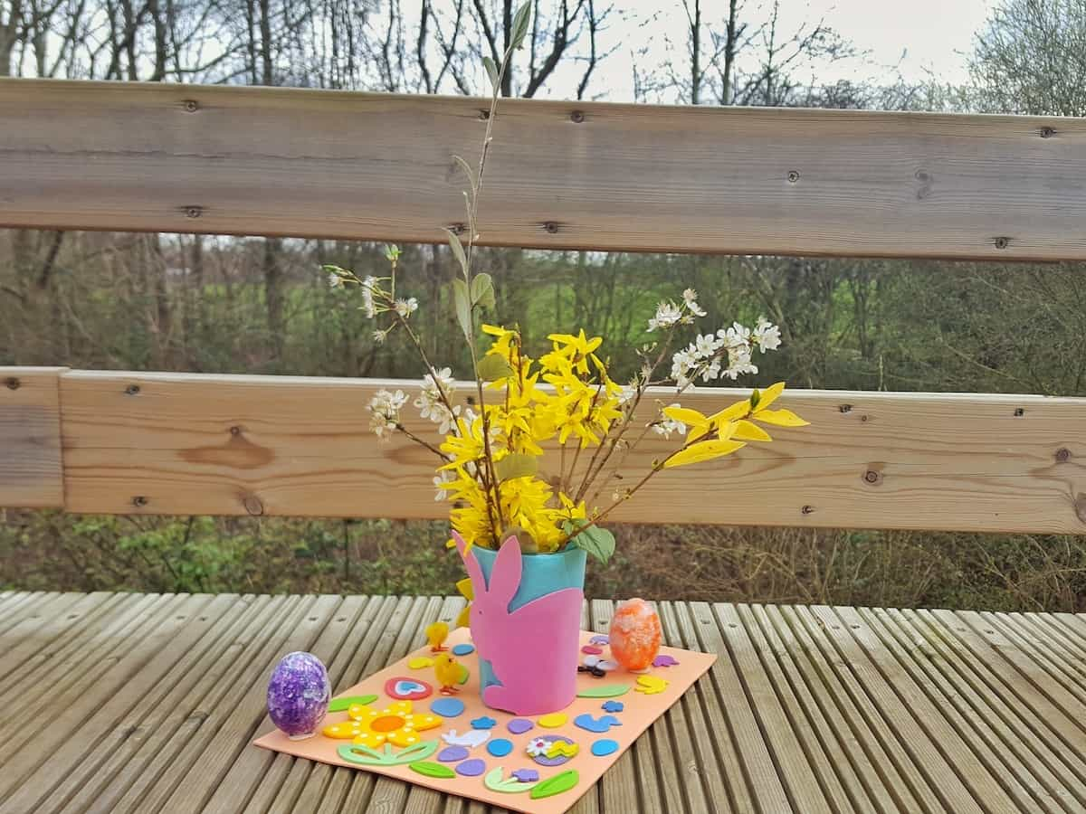 Craft for children - an easy Easter table decoration. This is a great craft for kids to get involved with. There are simple bits for them to do such as fixing stickers on, while you can get on with the more complicated bits like glueing and sticking. This craft incorporates nature and allows you to bring a little bit of Spring into your home this Easter.