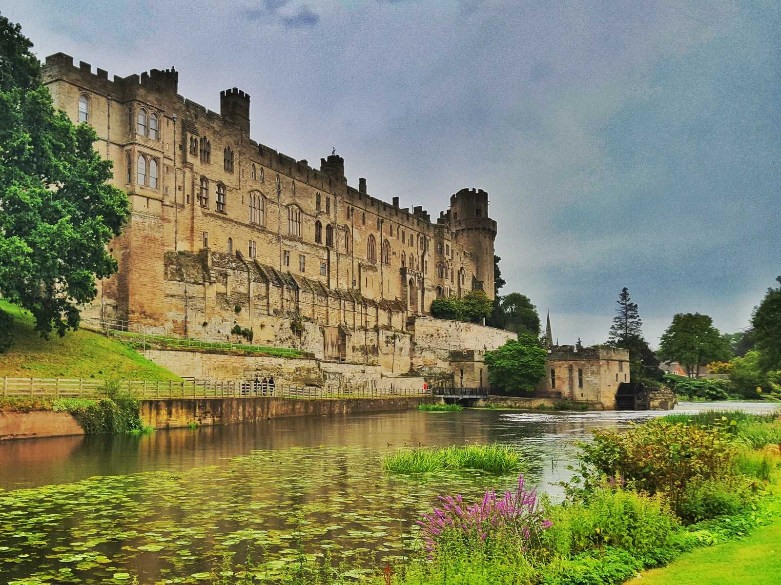 A view of Warwick Castle from across the moat