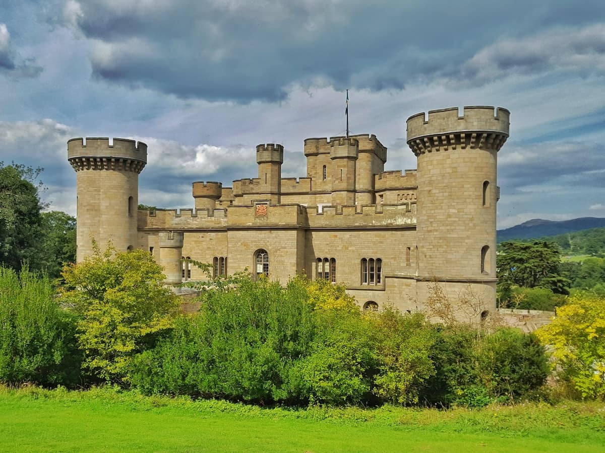 Eastnor castle in herefordshire against a stormy sky