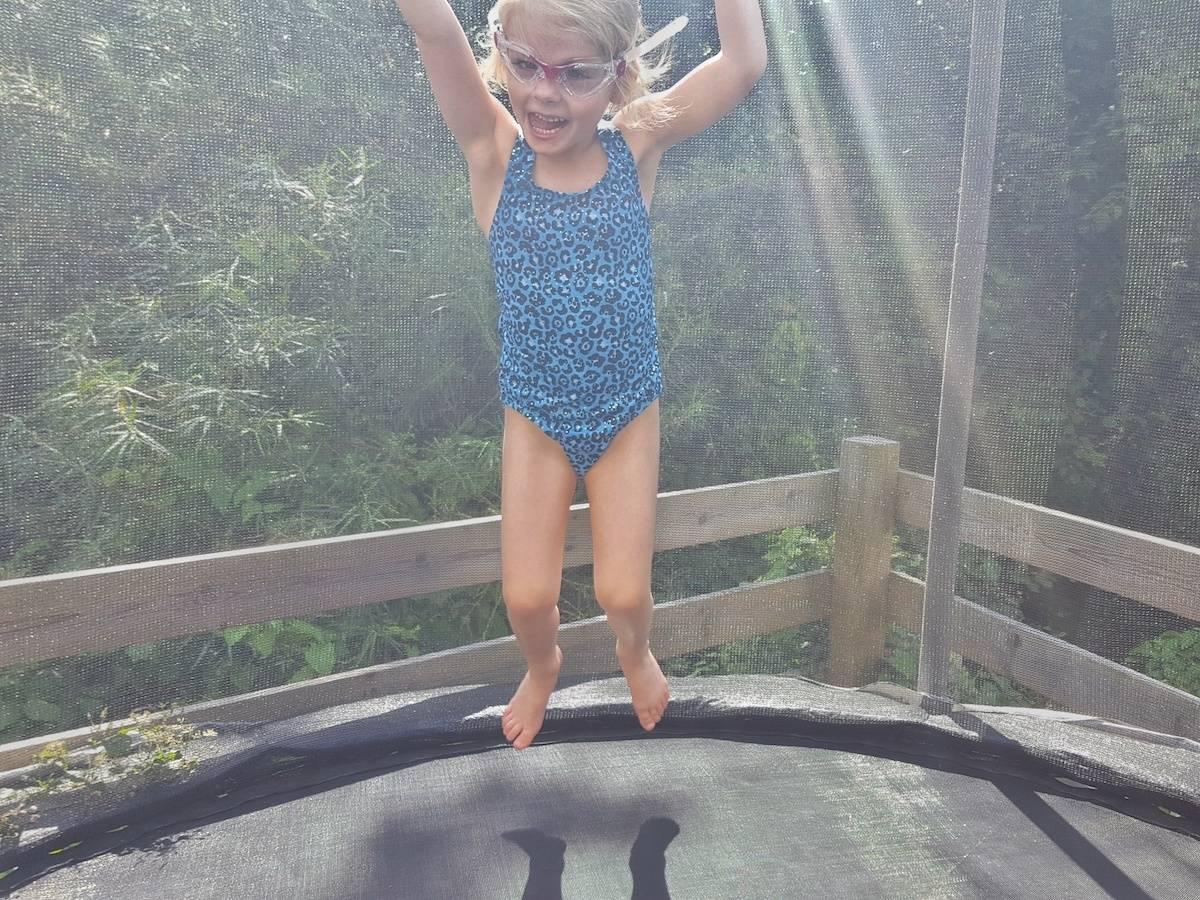 Halocline chlorine resistant swimwear from simply swim little girl on trampoline