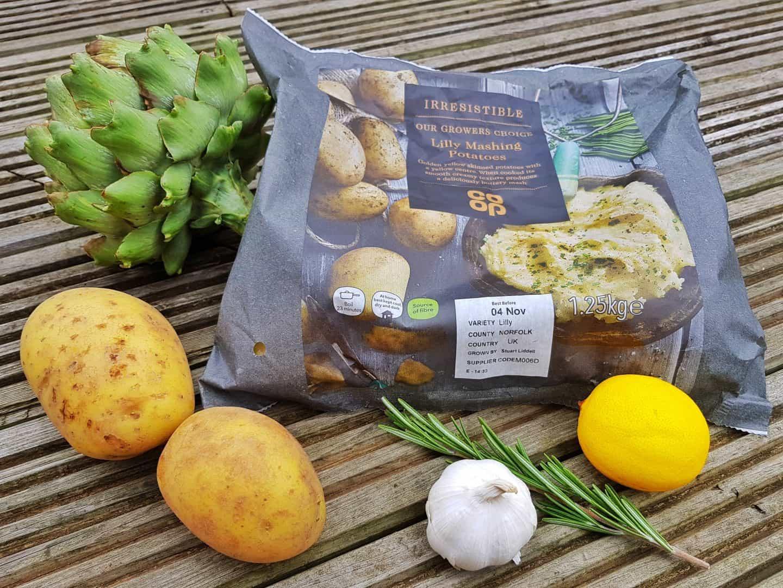 Globe artichokes with potato cakes and a lemon butter dip