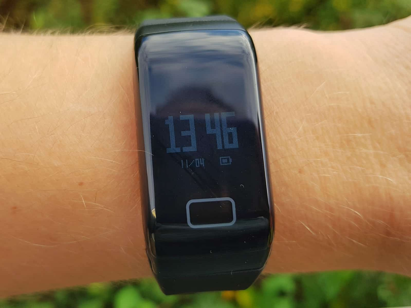 FourFit health band on wrist showing time
