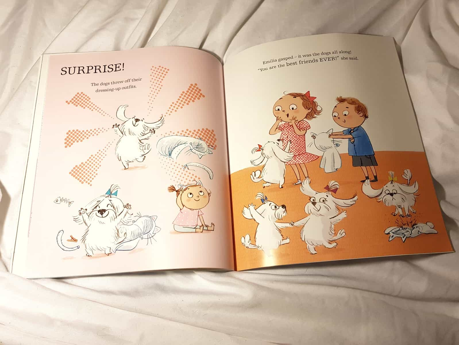 Pages of The Great Cat Nap with dogs removing their fancy dress clothing and shouting surprise