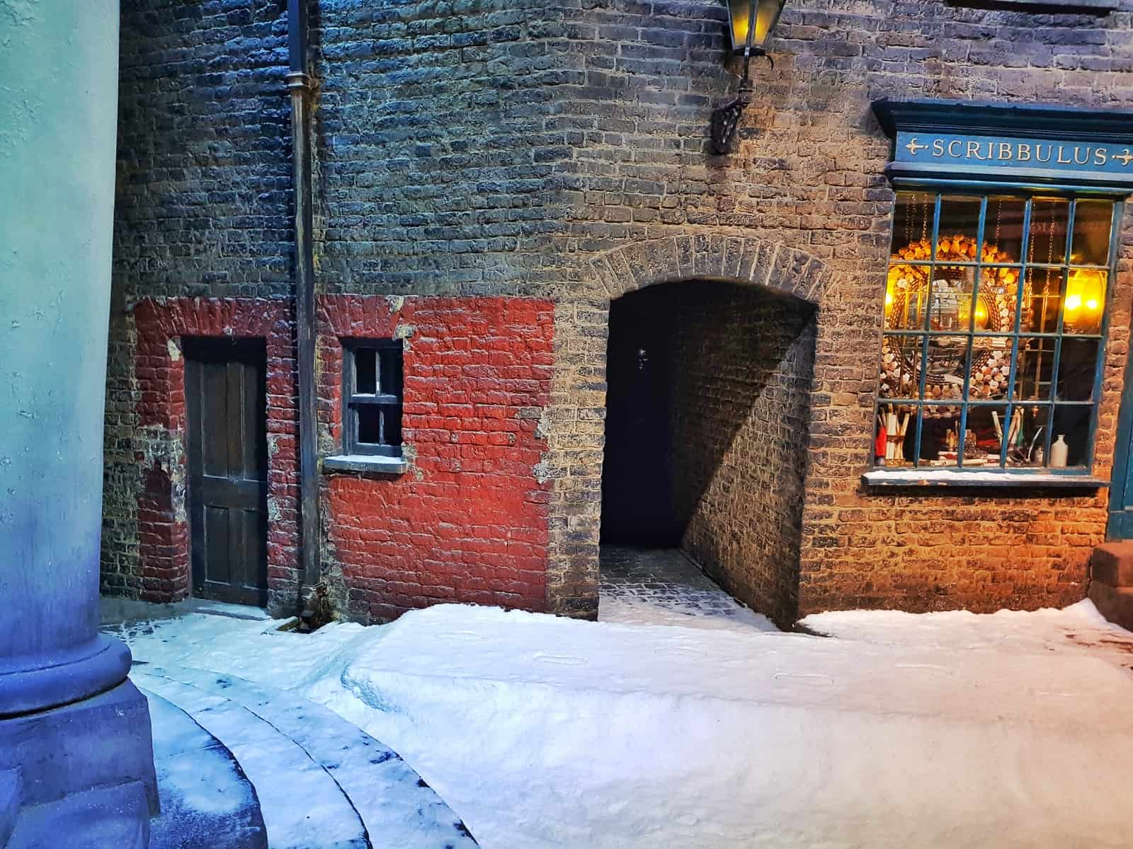 building on diagon alley with footprints in the snow outside
