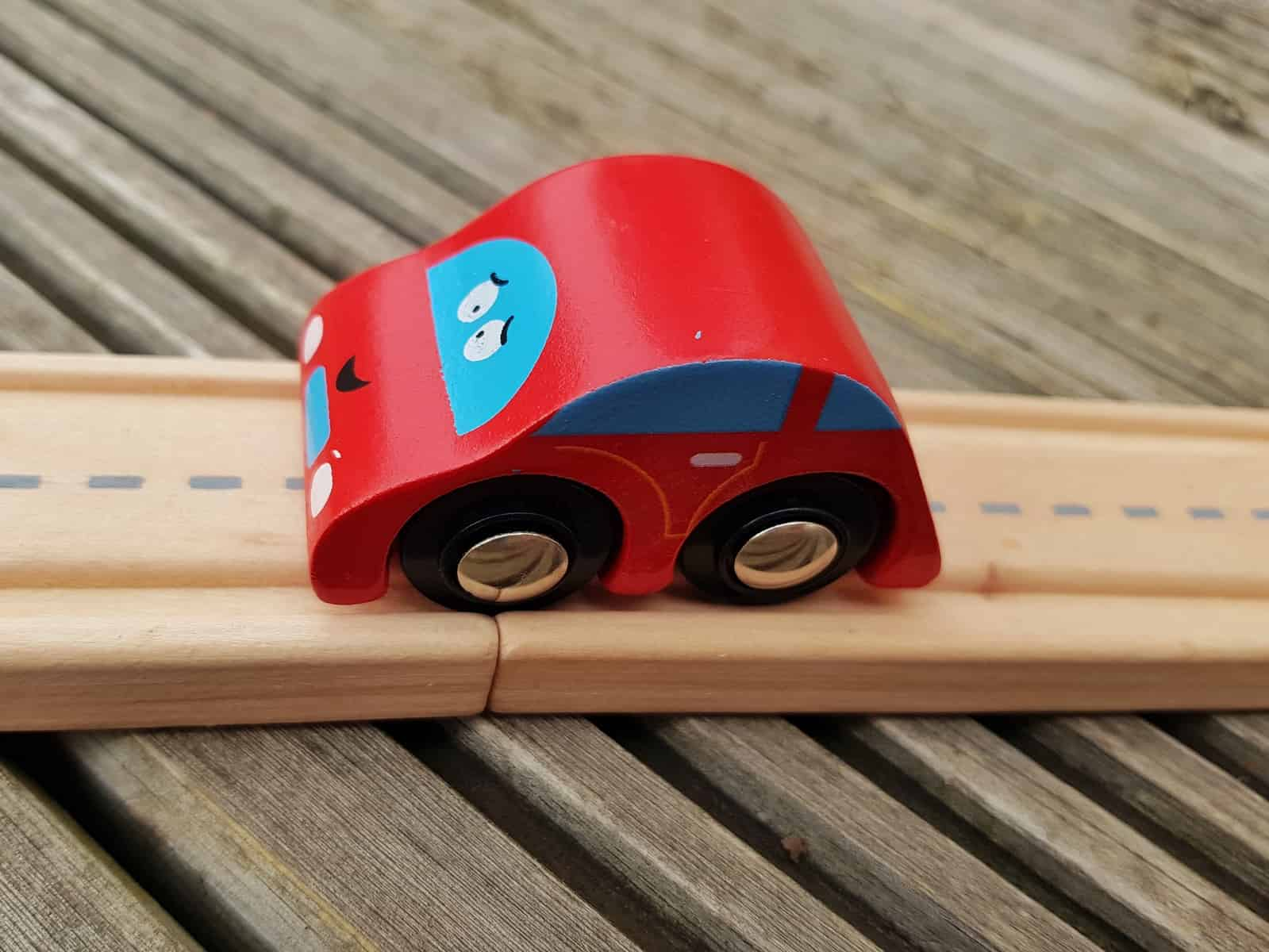 wooden toy car on wooden toy road