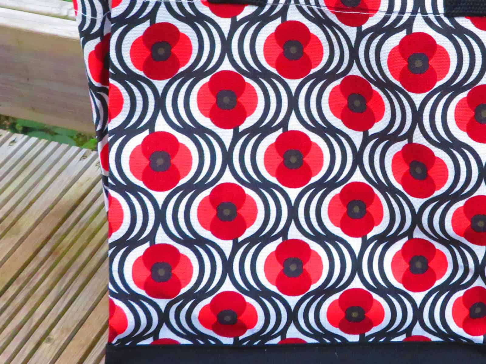 close up of poppy pattern on tote bag