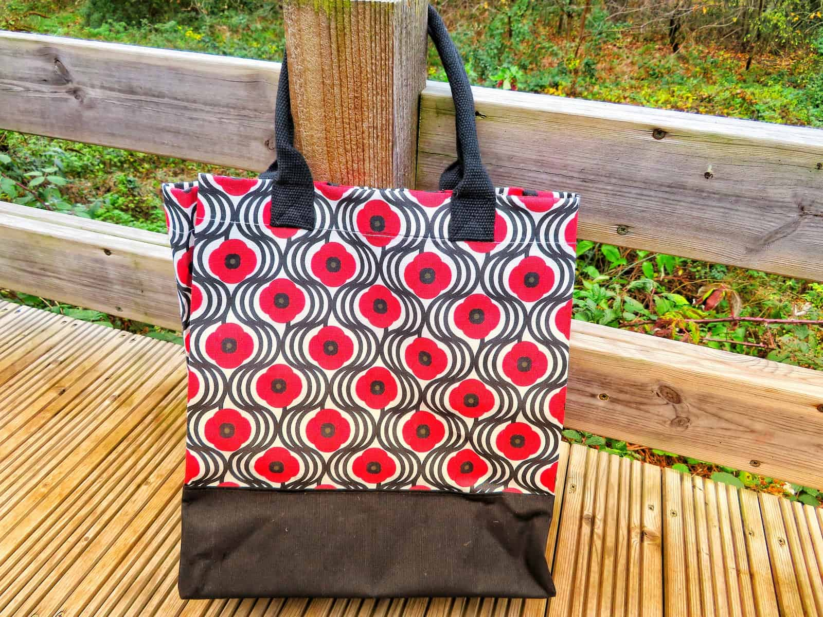 Designer tote bag with poppies on
