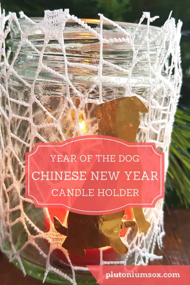 Chinese New Year of the Dog Craft | This is a spectacularly easy craft for children to mark the start of the Chinese New Year of the Dog. This candle holder is made from an upcycled jar, webbing paper or lace and a dog shape that you can make yourself. You will also need a tea light candle, scissors and glue. This easy craft is perfect for making with children and takes only a few minutes.
