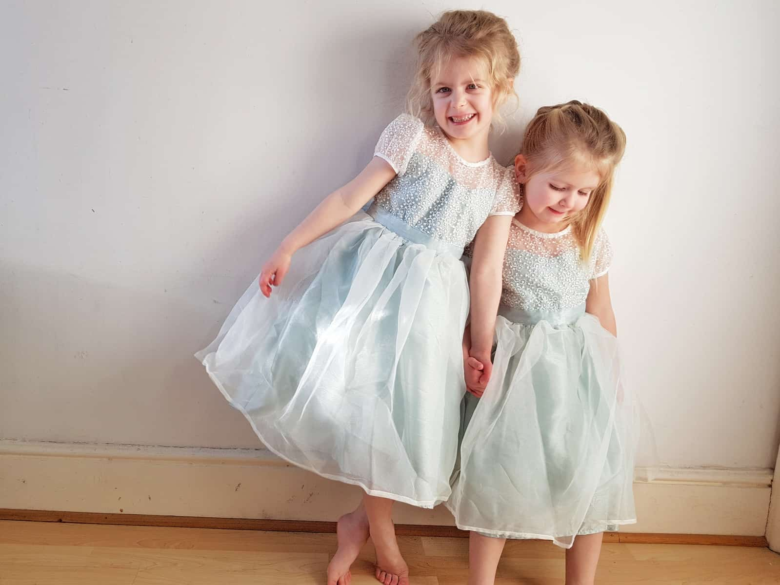 two little girls in mint green flower girl dresses