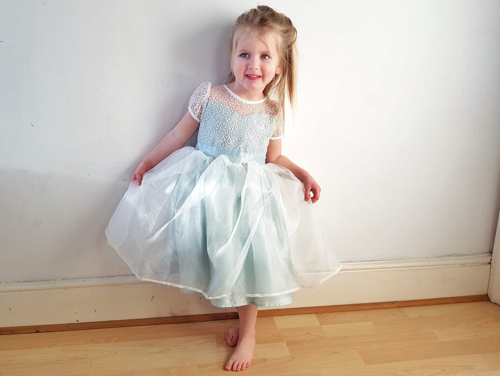 little girl in a mint green flower girl dress