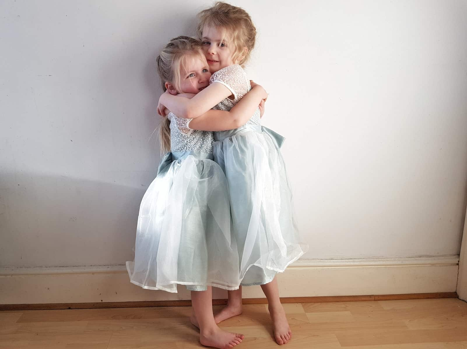 two little girls in mint green flower girl dresses