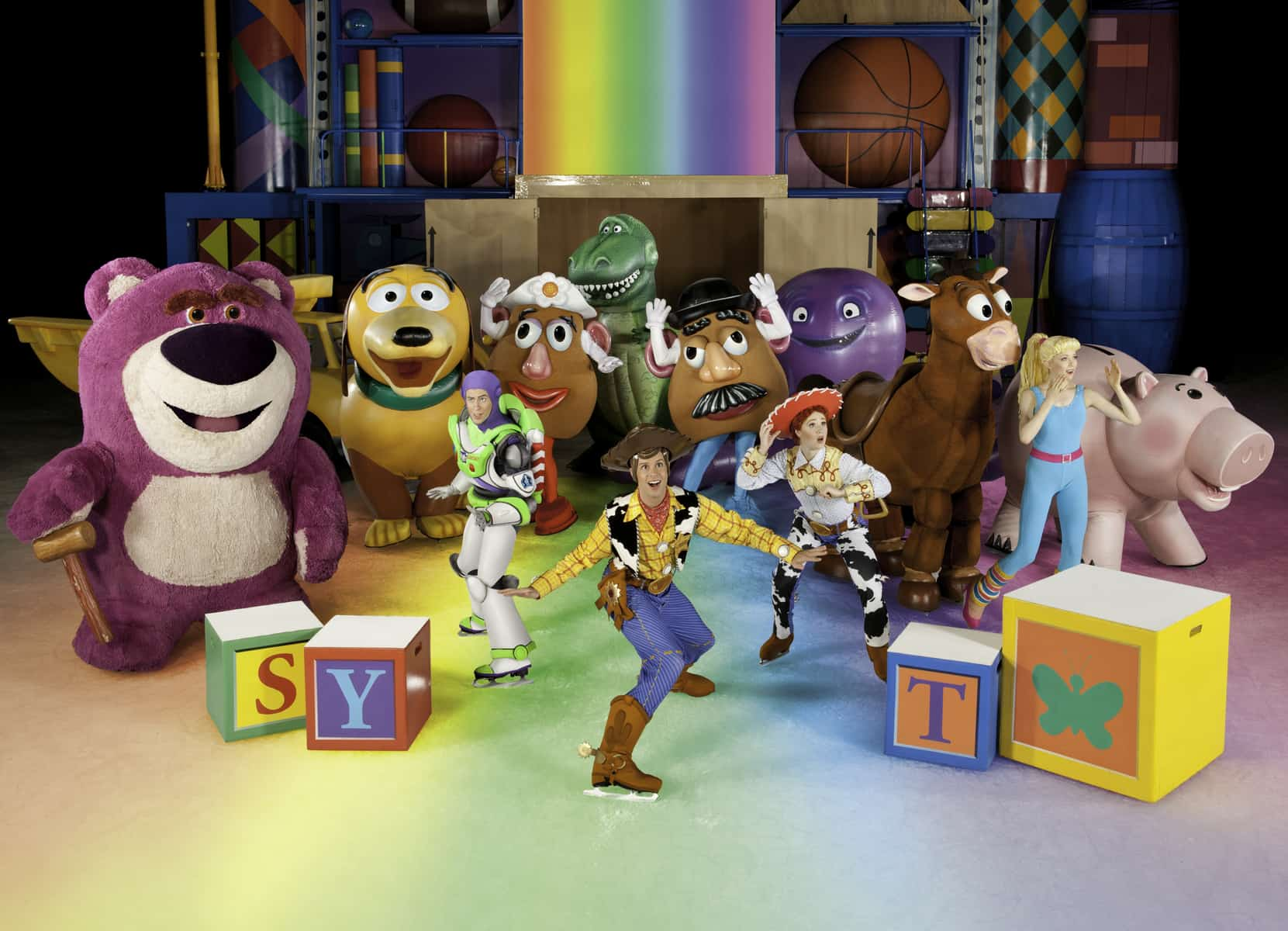 Numerous characters from toy story on ice skates as part of Disney on Ice Worlds of Enchantment