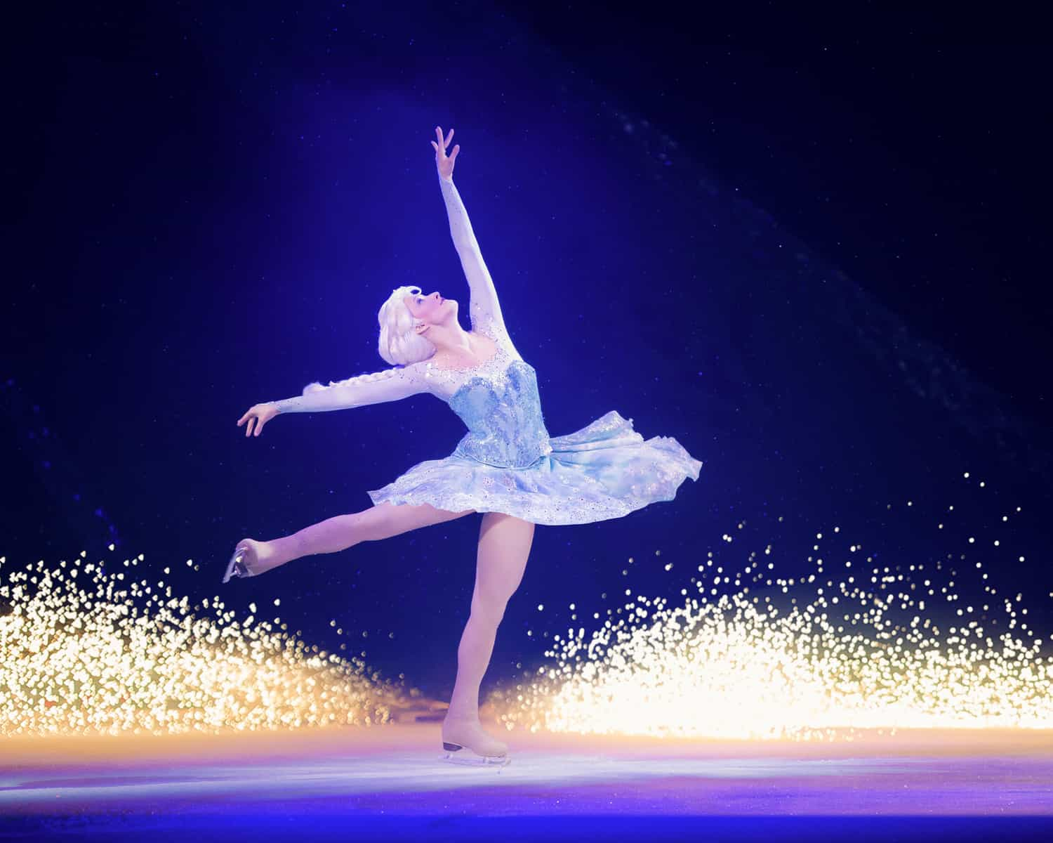 Elsa doing a pirouette on ice skates as part of Disney on Ice Worlds of Enchantment
