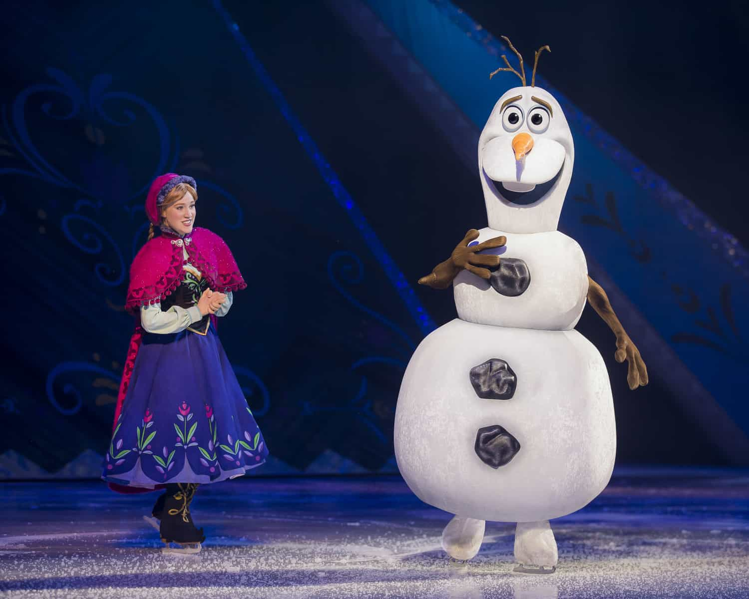 Anna and Olaf on ice skates as part of Disney on Ice Worlds of Enchantment