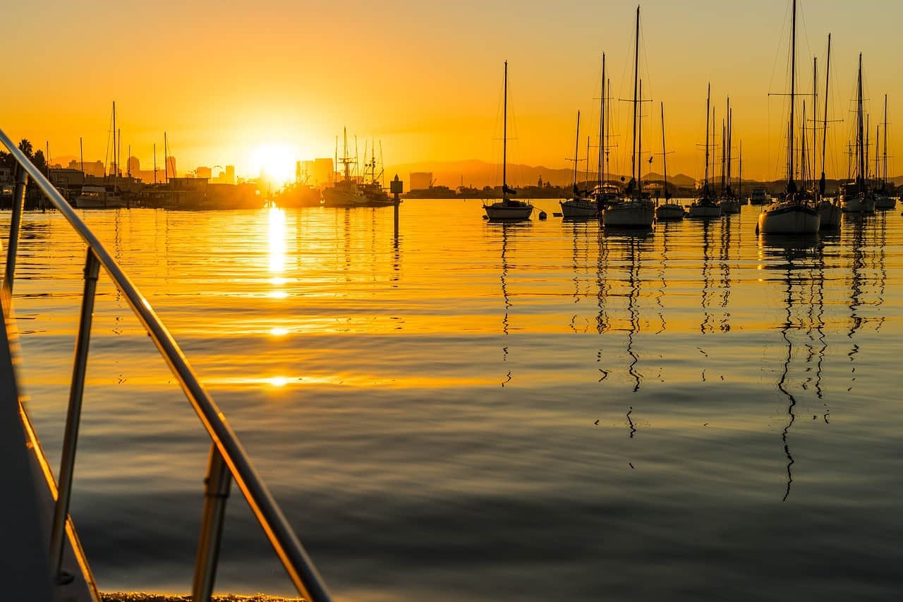 San Diego harbour at sunset with small boats in the water