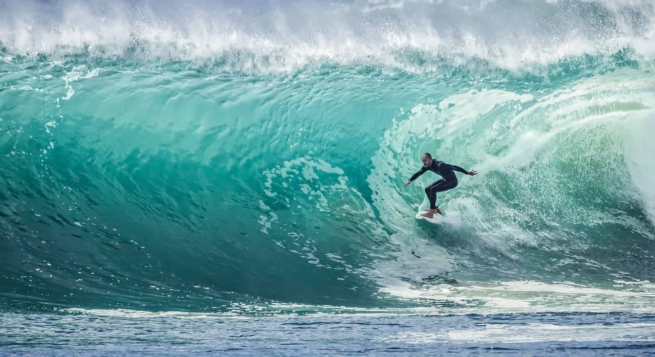 surfer in the centre of a wave