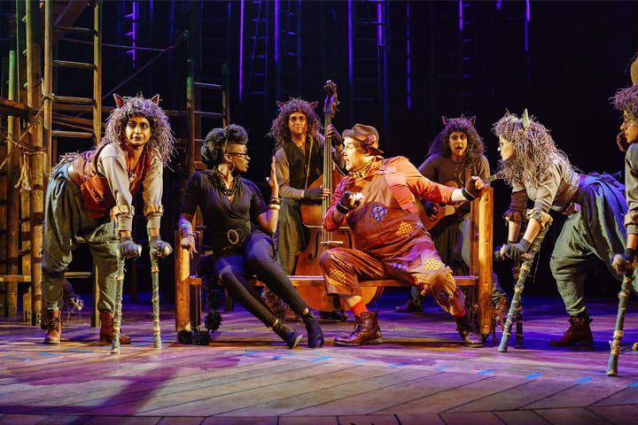 Baloo, Bagheera and the wolf pack on stage in The Jungle Book at Malvern Theatres.