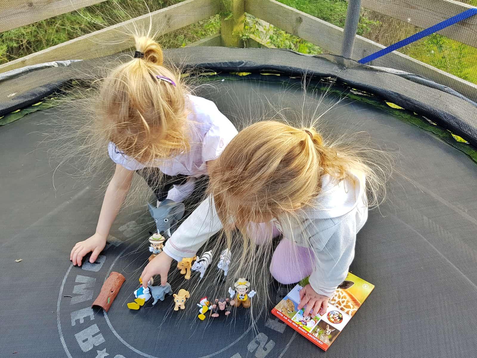 Children bending over Disney Animal World Toys