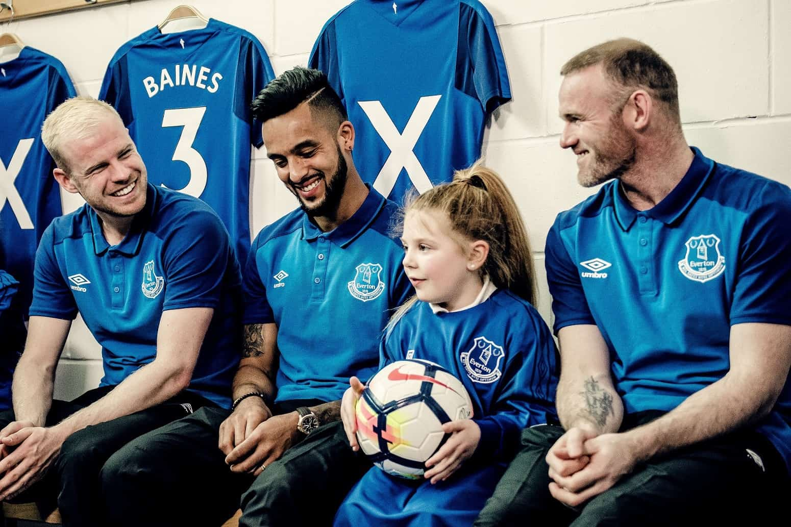 Everton FC's Davy Klaasen, Theo Walcott and Wayne Rooney surprise a young fan as part of the Premier League's Best Lesson Ever