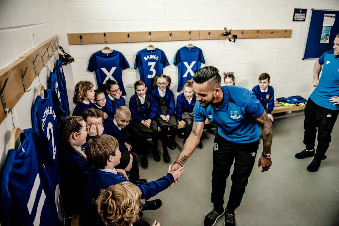 Theo Walcott with children on the Premier League Primary Stars programme
