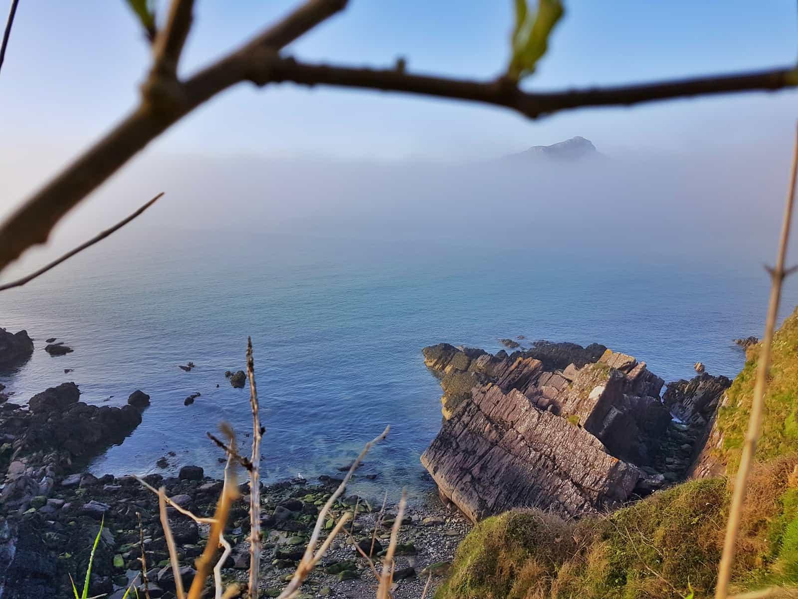 A coastal view from cliffs above Porthsele, a Pembrokeshire beach near Pencarnan farm