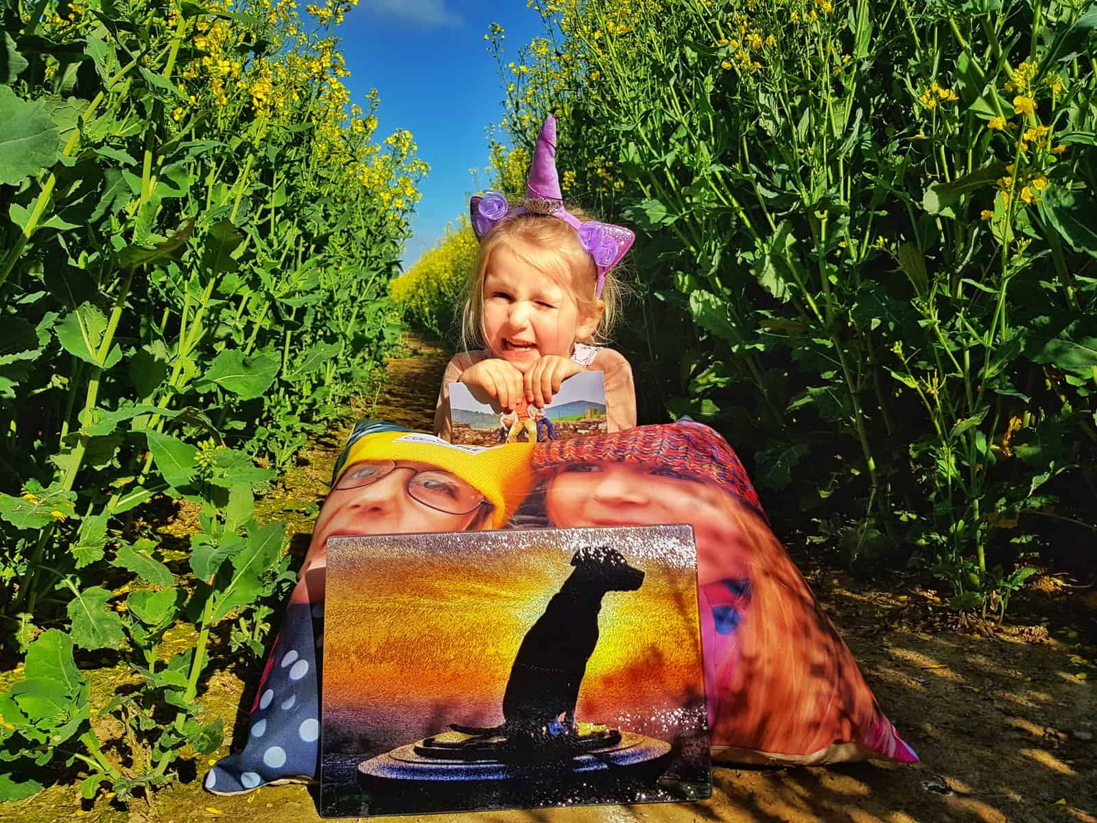 little girl holding cushion with photo of children on it, personalised father's day card and chopping board with sunset photo of dog on
