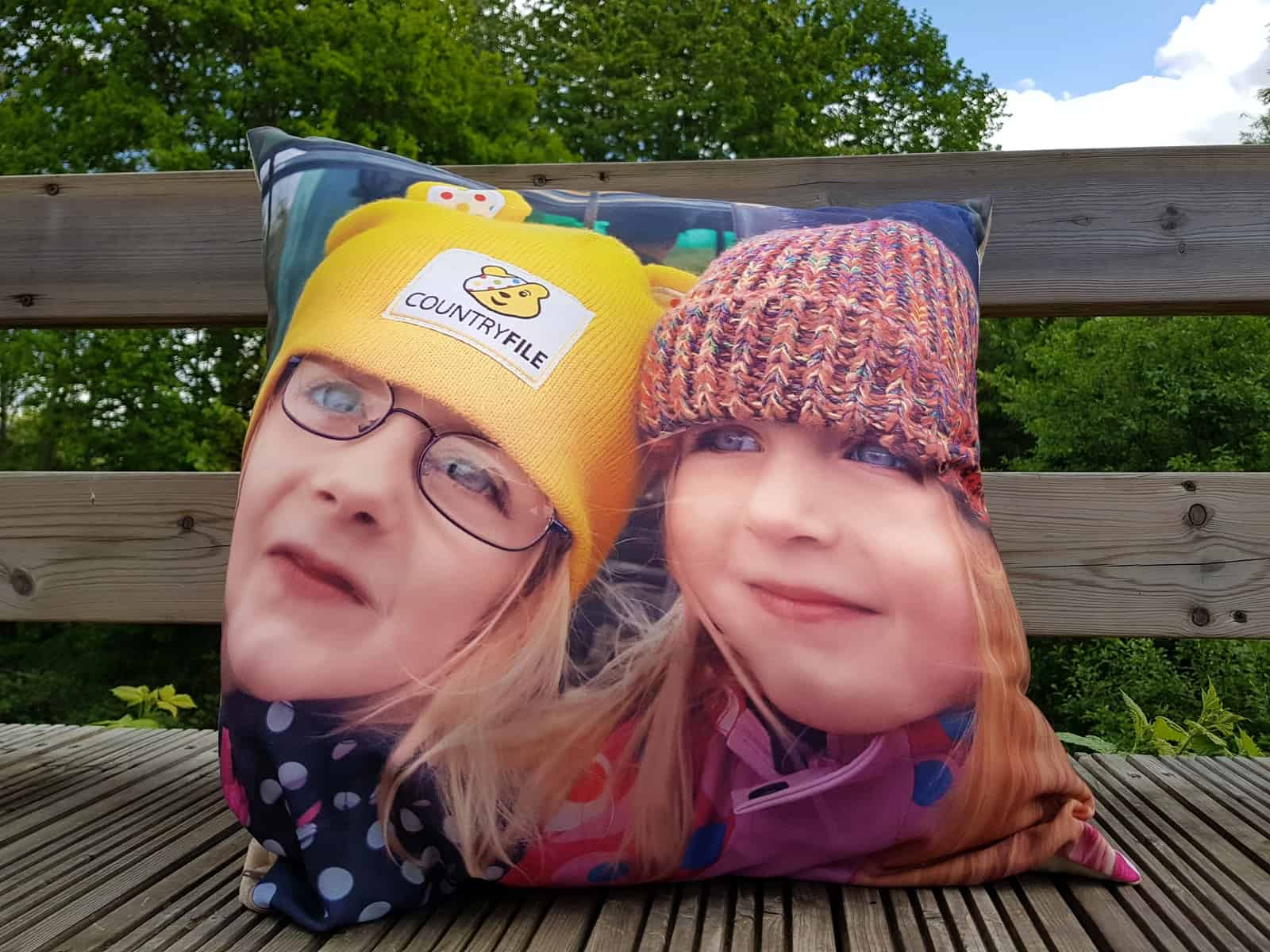 cushion with a photo of two little girls on it