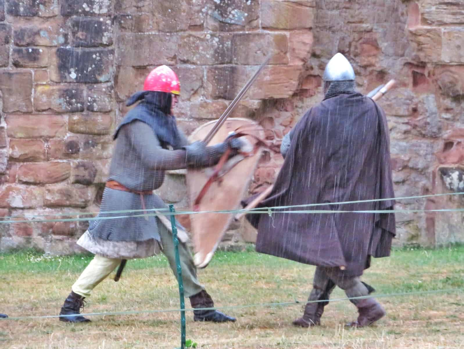 Kenilworth Castle Warwickshire soldiers in armour fighting