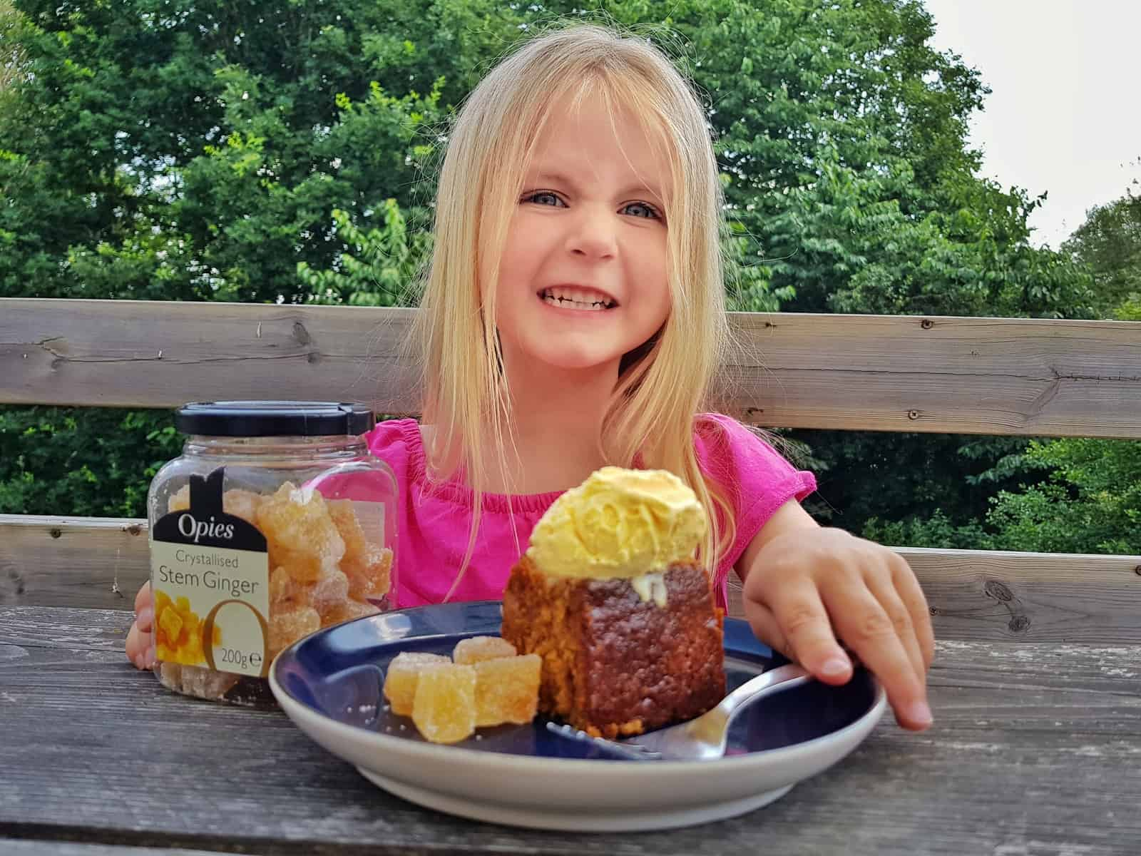 little girl with opies stem ginger cake