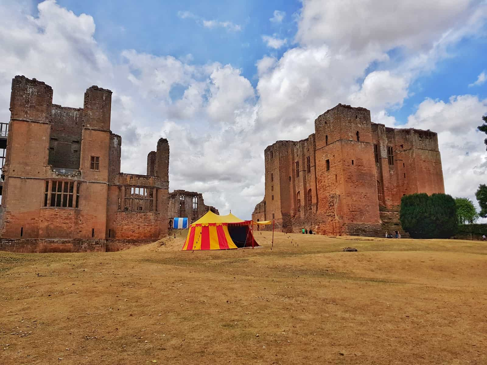 Kenilworth Castle Warwickshire colourful tent by castle