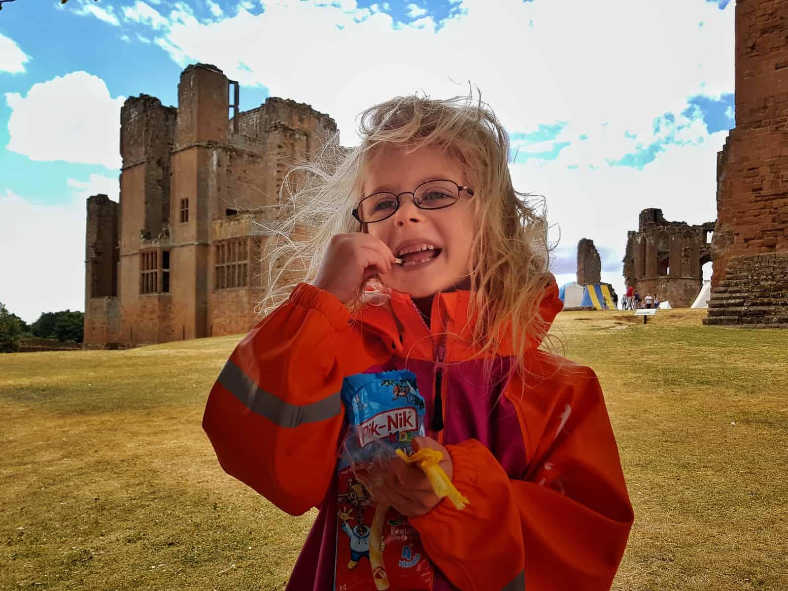 Pik-Nik cheese sticks girl eating outdoors