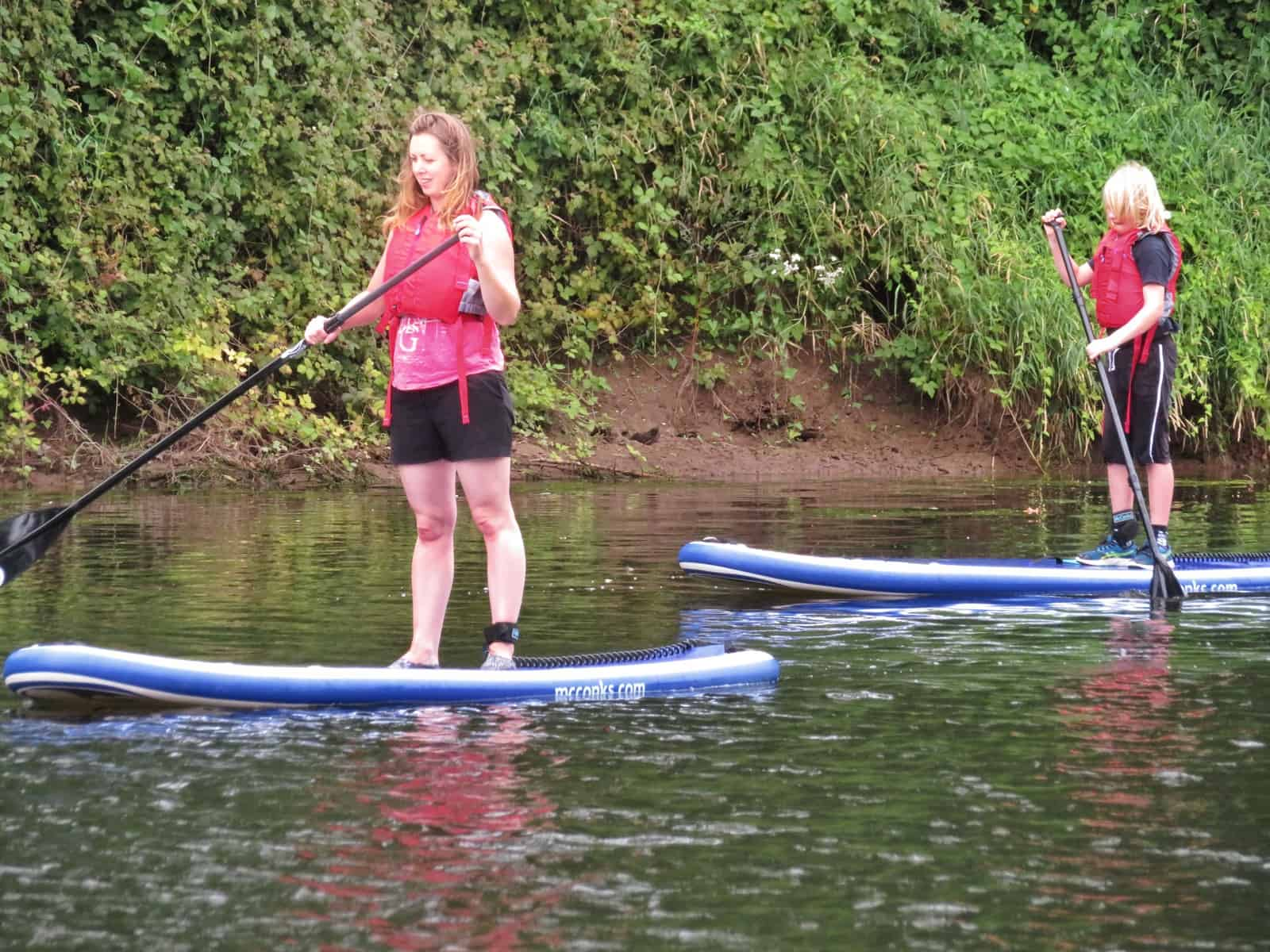 Inspire2Adventure SUP lesson two people standing on SUPs