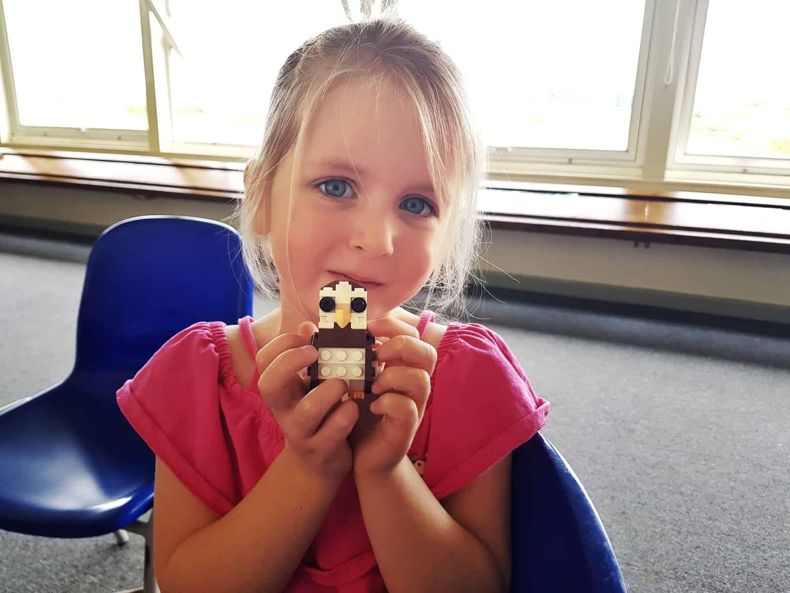 WWT Slimbridge, Gloucestershire - little girl showing off lego owl