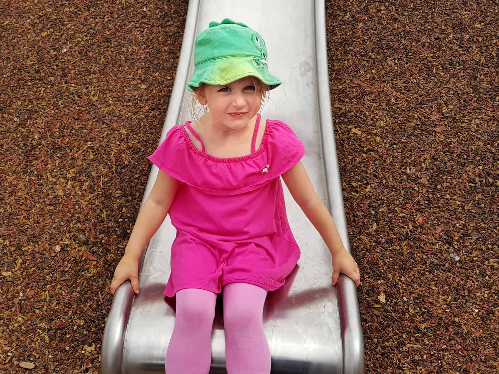 WWT Slimbridge, Gloucestershire - little girl on metal slide