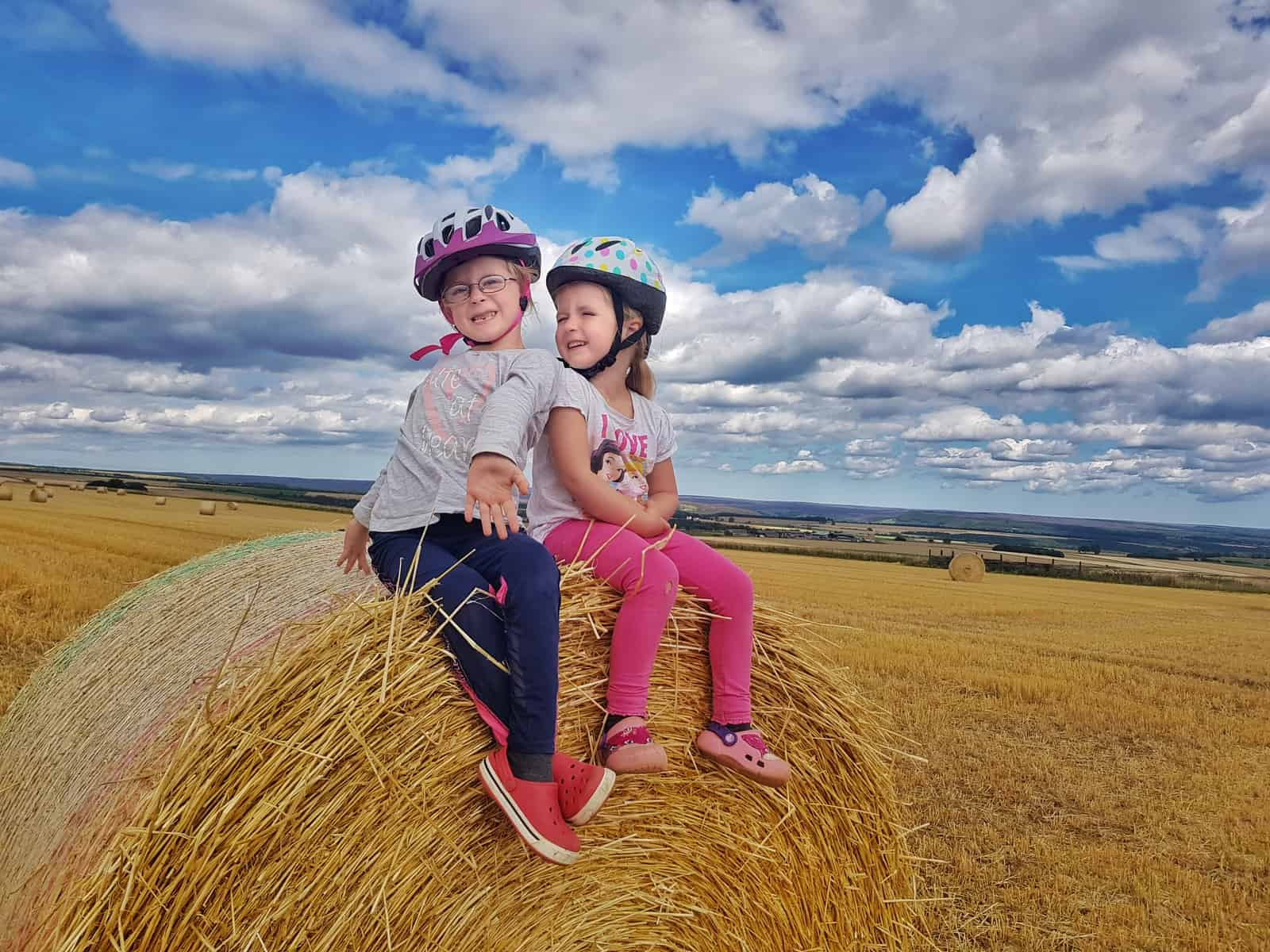Cycling at Sutton Bank National Park Centre resting on a hay bale