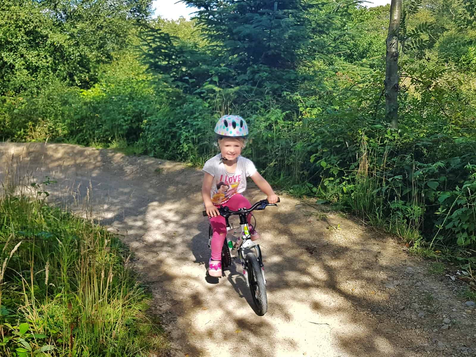 Cycling at Sutton Bank National Park Centre little girl cycling