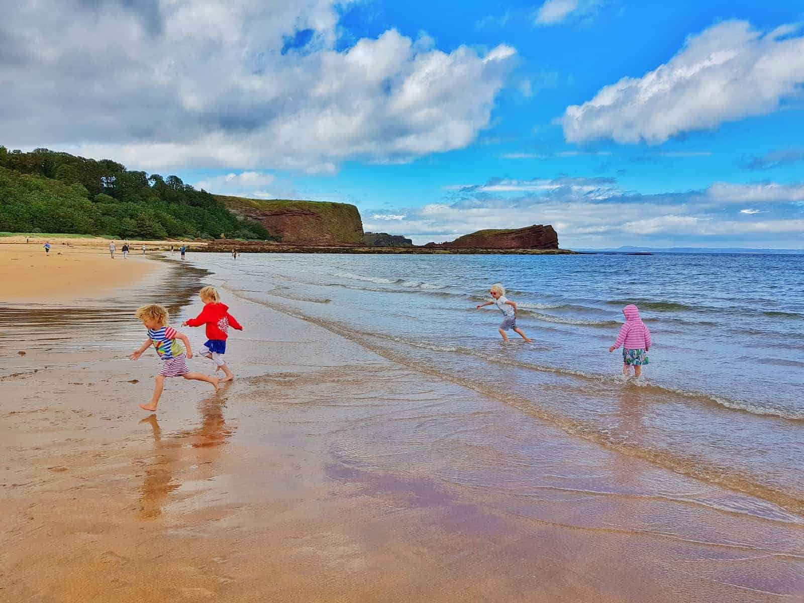 Tantallon Castle and Seacliff Beach East Lothian Scotland - children playing on beach