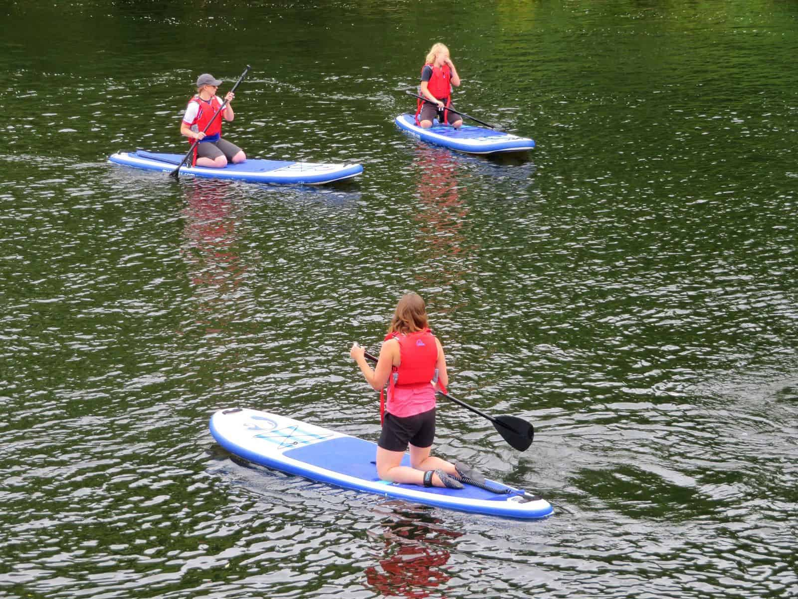 Inspire2Adventure SUP lesson kneeling on SUP