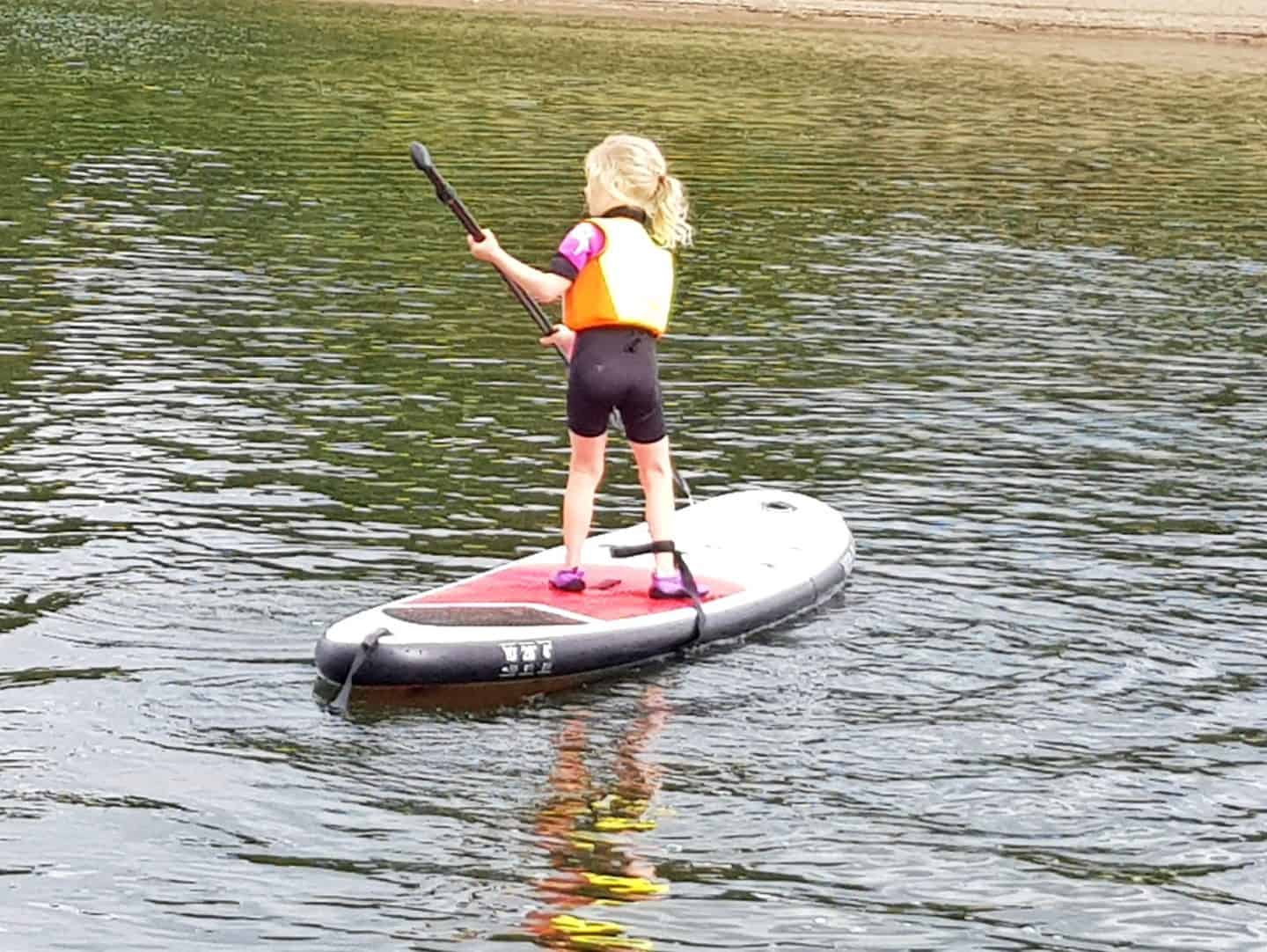 Hoburne Blue Anchor little girl on SUP at Wimbleball Lake