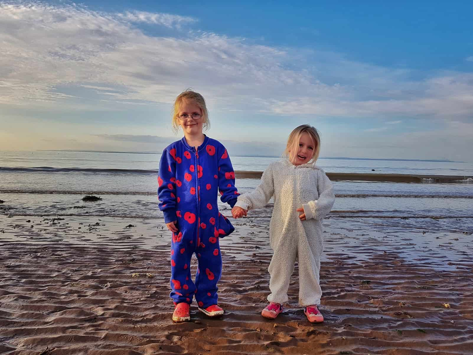 Hoburne Blue Anchor children on beach in onesies