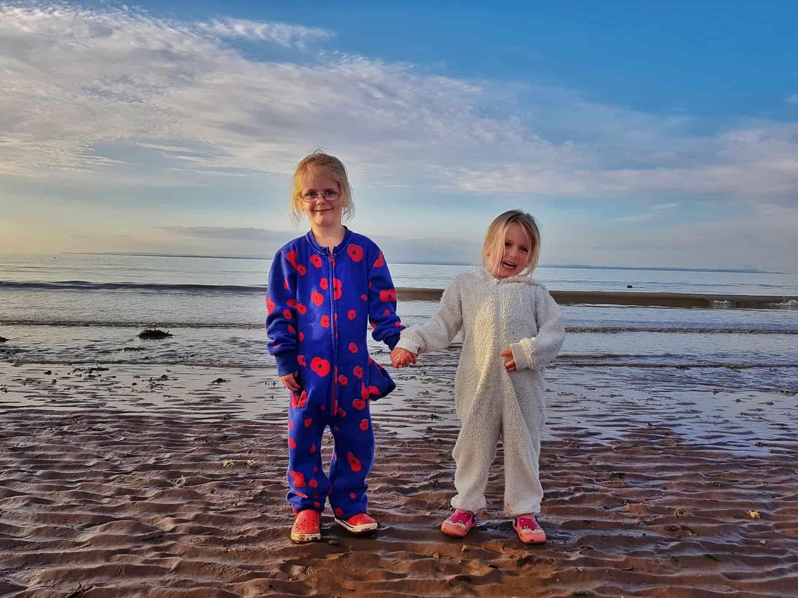 Hoburne Blue Anchor children on beach in onesies
