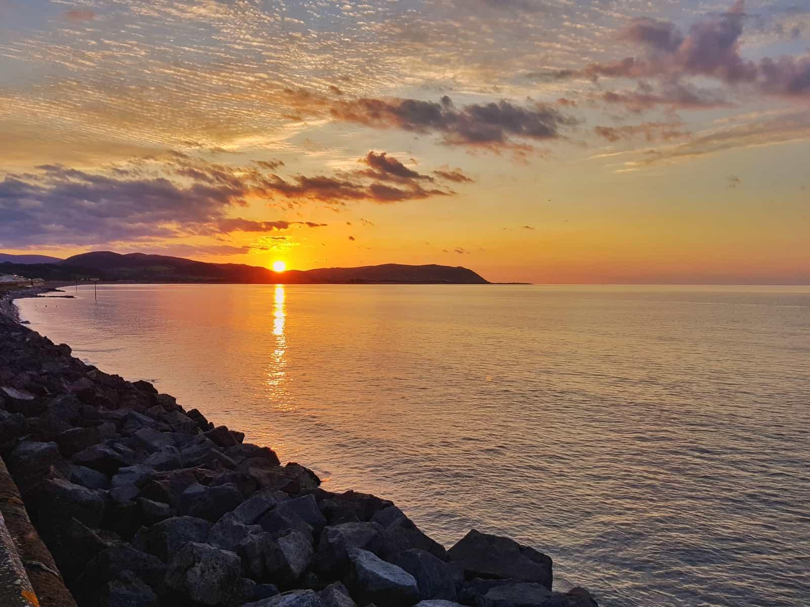 Hoburne Blue Anchor sunset over Blue Anchor Bay