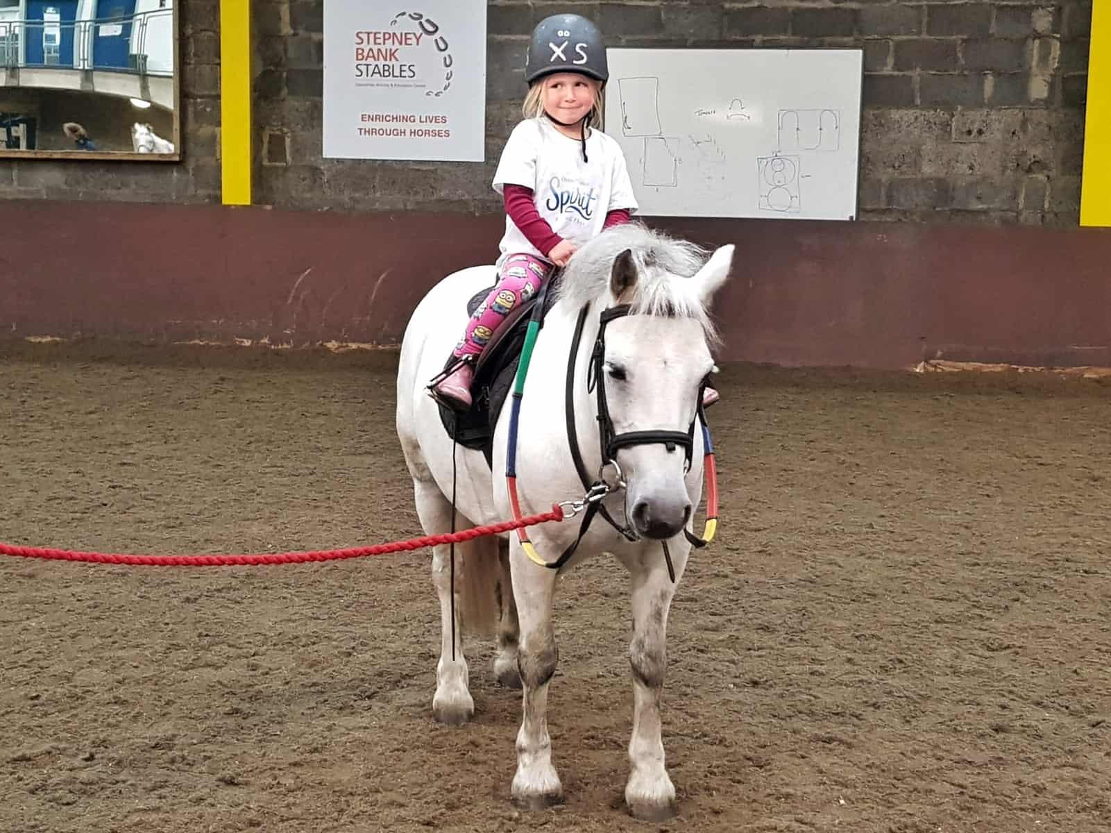 Spirit Riding Free Stable Sleepover girl on a white pony