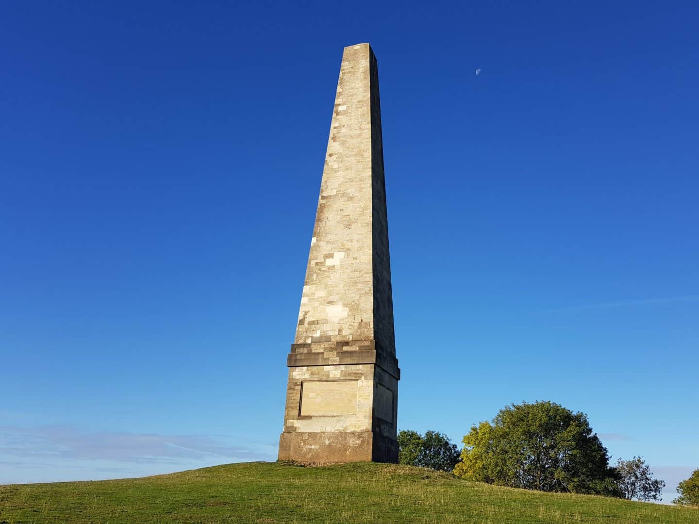 Obelisk Monument at Eastnor with blue sky and moon faintly showing