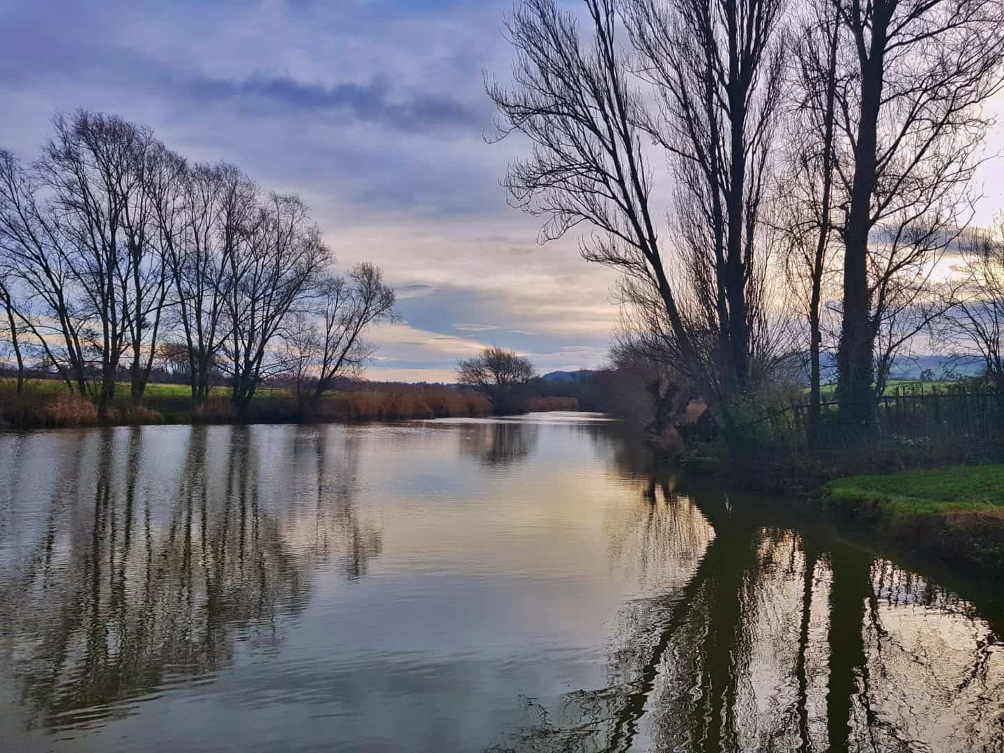 Depiction of the environment as a reason to do Veganuary. Image of a river reflecting the sky.