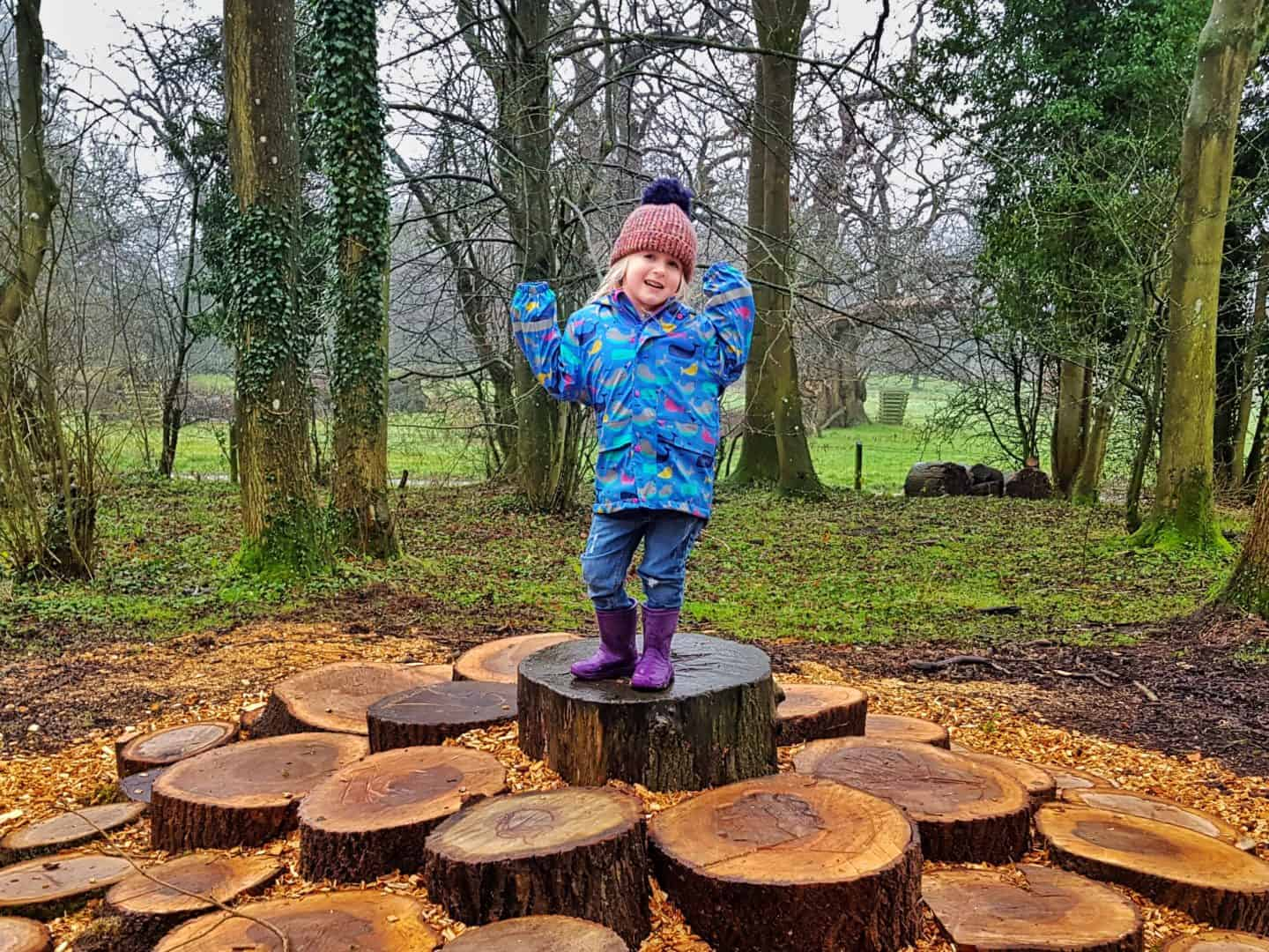 national trust membership little girl in blue coat on logs