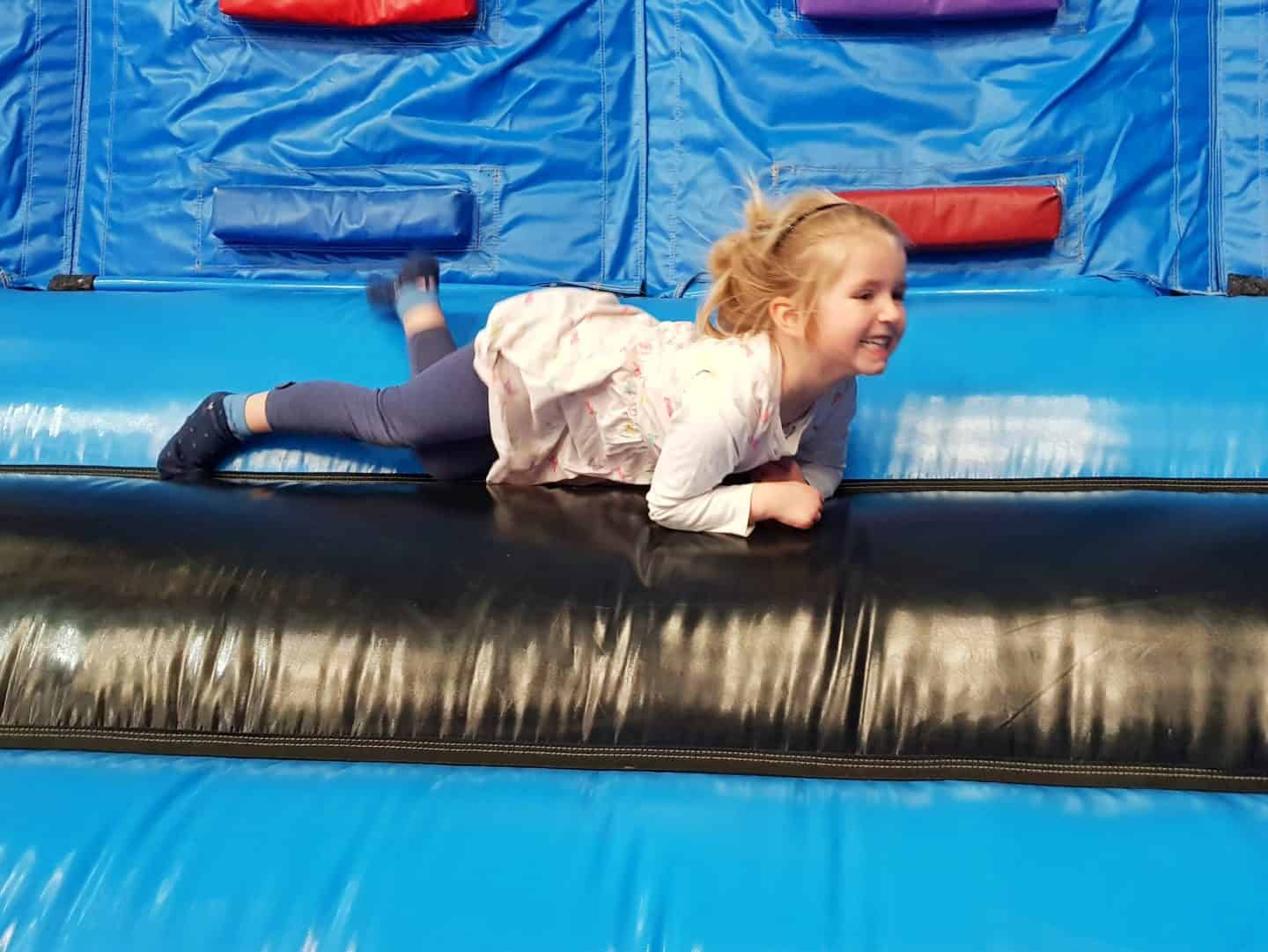 Inflata Nation Birmingham girl at bottom of climbing wall