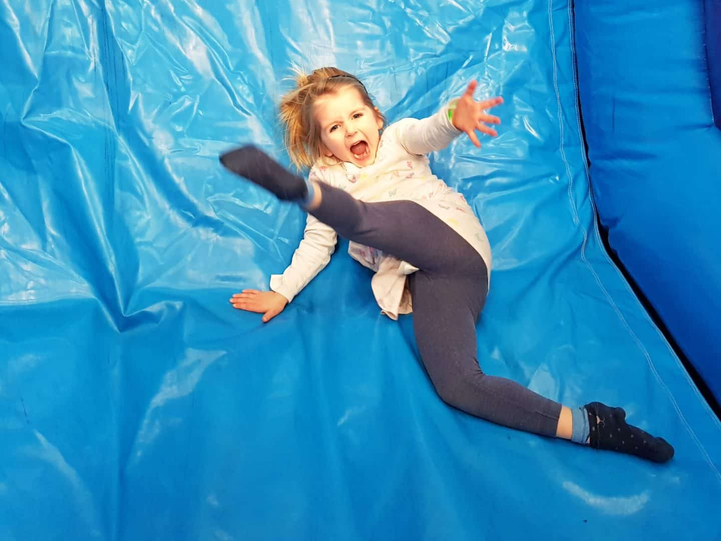 Inflata Nation Birmingham girl at bottom of slide