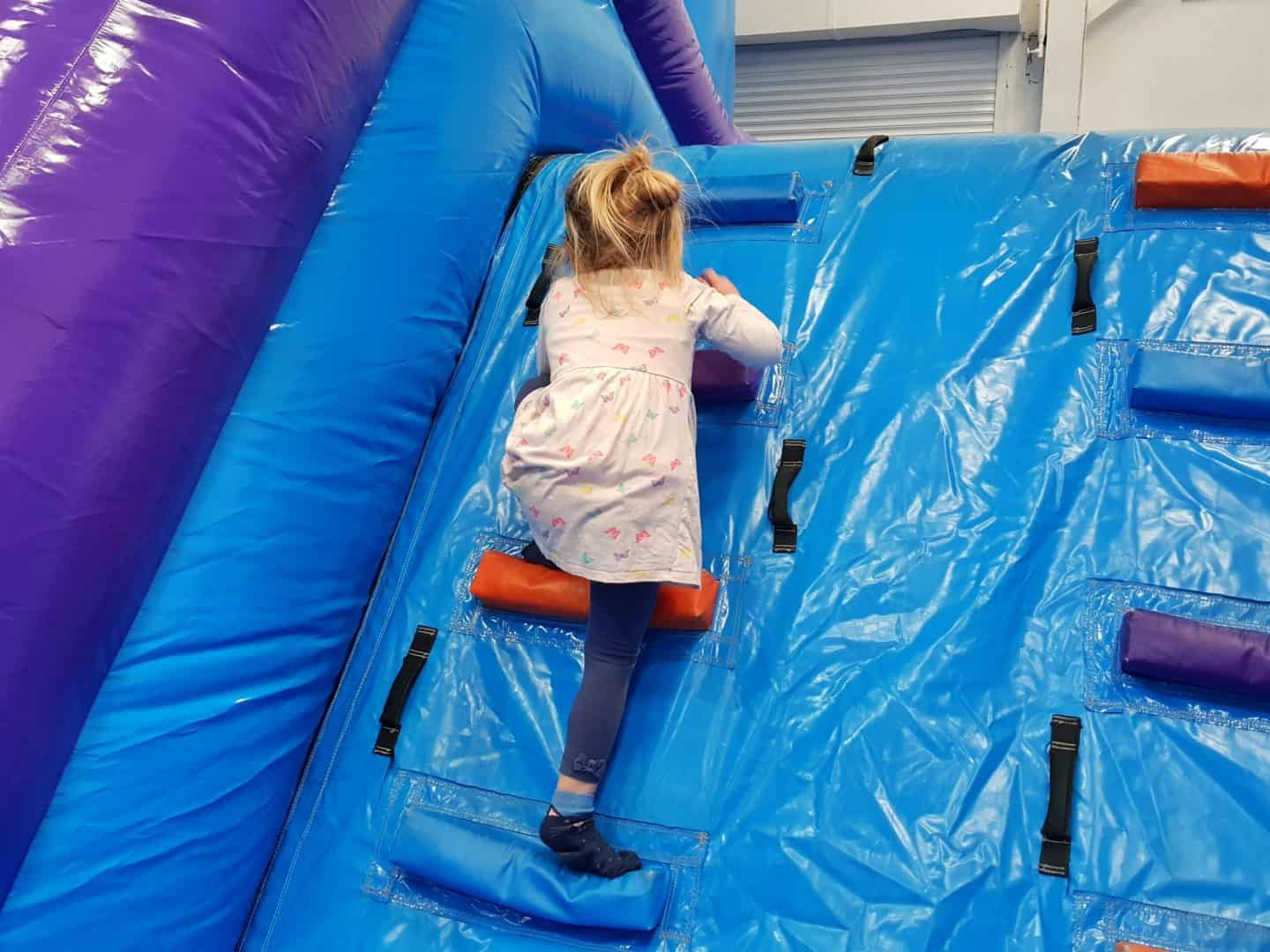 Inflata Nation Birmingham girl climbing on obstacle course
